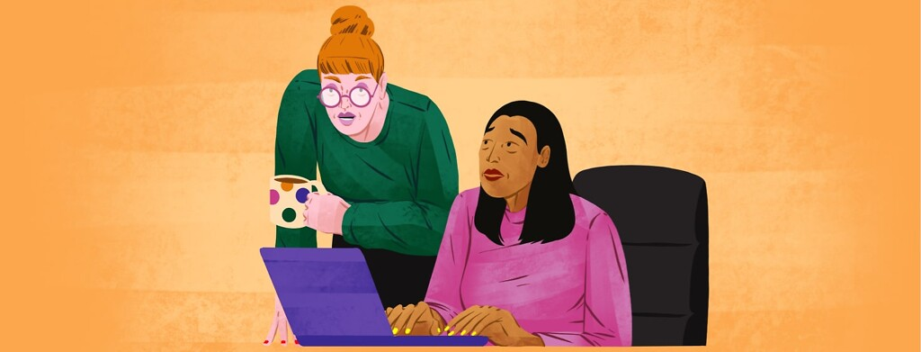 alt=A woman sitting at a desk nervously looks up at her boss, who is leaning over her desk, looking at her laptop.